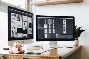 two computer screens open on web design